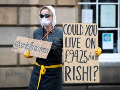 Protesters have also called for improvements to sick pay (Jane Barlow/PA)