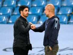 Manchester City manager Pep Guardiola (right) believes his former assistant Mike Arteta (left) will turn Arsenal into Premier League title contenders (Peter Powell/NMC Pool)