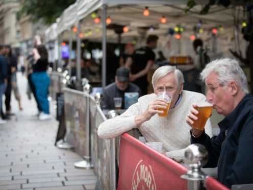 Members of the public enjoy their first drink in the beer garden at the Bier Halle, Glasgow (Jane Barlow/PA)