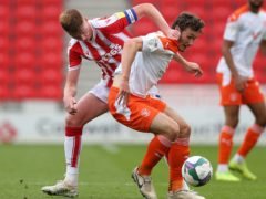 Blackpool's Matty Virtue, right, should be available against Rochdale (Barrington Coombs/PA)