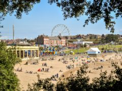 People on the beach at Barry Island in August 2020 (Ben Birchall/PA)