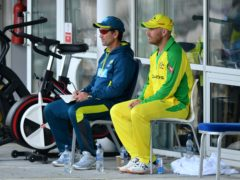Justin Langer, left, has come under scrutiny for his coaching style but Aaron Finch, right, has played down talk of discontent among players (Bradley Collyer/PA)