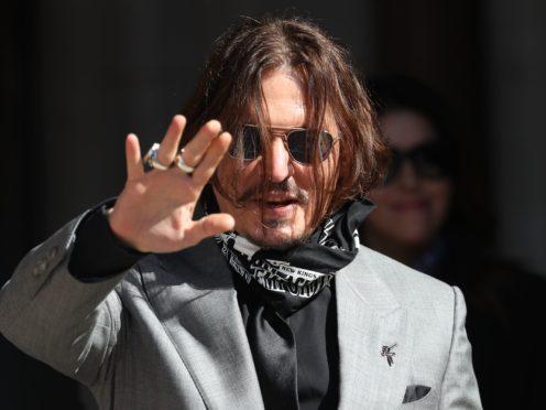 Johnny Depp lost a UK libel claim against The Sun last year (Yui Mok/PA)