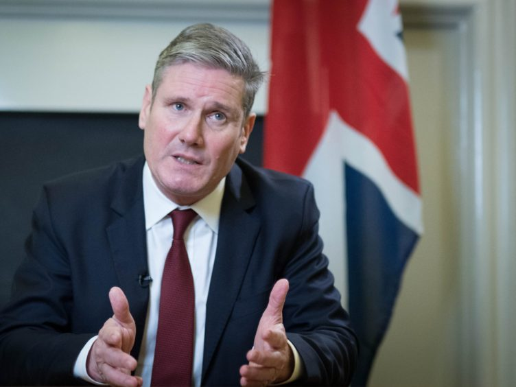 Labour leader Sir Keir Starmer has appeared in front of a Union flag in recent media clips (Stefan Rousseau/PA)