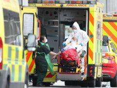 Paramedics transport a patient from an ambulance into the Royal London Hospital (Yui Mok/PA)