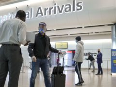 Passengers arriving in Terminal 2 at Heathrow Airport in London (Steve Parsons/PA Wire)