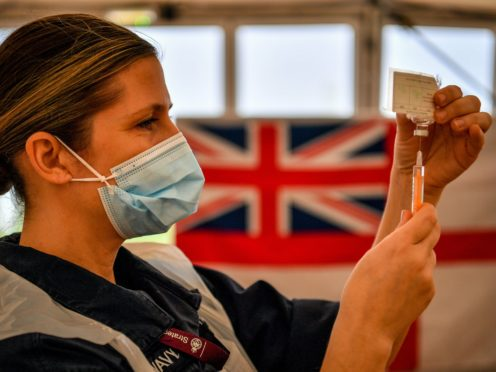 Royal Navy personnel prepare to give vaccines to the public at a coronavirus vaccination centre in Bath (PA)
