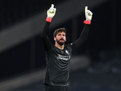 Liverpool goalkeeper Alisson Becker is set to return against Manchester City (Catherine Ivill/PA)