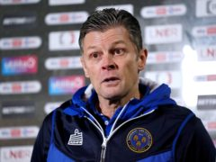 Manager Steve Cotterill, pictured, has still been guiding Shrewsbury despite remaining in hospital battling Covid-19 (Zac Goodwin/PA)