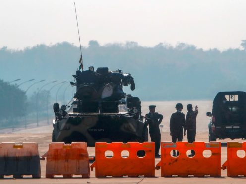Myanmar's military stand guard at a checkpoint in Naypyitaw after Monday's coup (AP Photo)