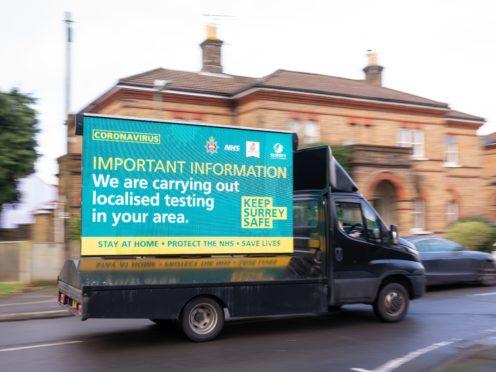 A mobile billboard announces door-to-door coronavirus testing in Woking, Surrey (Dominic Lipinski/PA)