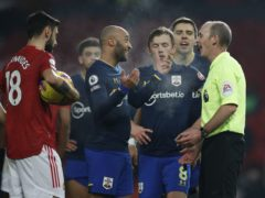 Mike Dean awarded a late penalty at Old Trafford on Tuesday (Phil Noble/PA)