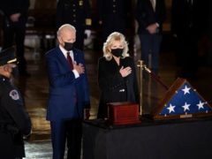 President Joe Biden and first lady Jill Biden pay their respects to US Capitol police officer Brian Sicknick as an urn with his cremated remains lies in honour (Brendan Smialowski/Pool/AP)
