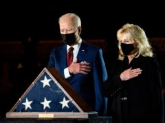 US president Joe Biden and first lady Jill Biden pay their respects to the late US Capitol Police officer Brian Sicknick in the Capitol Rotunda (Erin Schaff/The New York Times/Pool/AP)