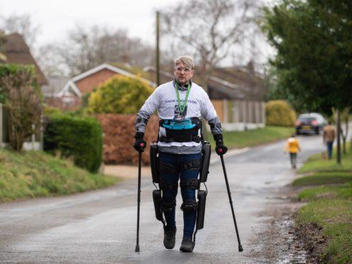 Charity fundraiser Simon Kindleysides, 36, walks from Blofield to Brundall in Norfolk, using a ReWalk exoskeleton suit. (Joe Giddens/ PA)