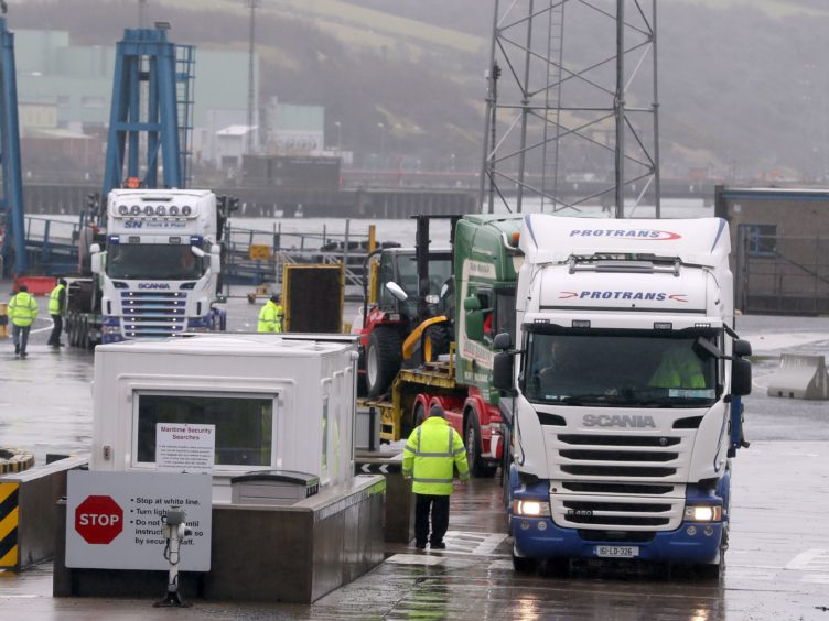Lorries leaving Larne Port (Brian Lawless/PA)