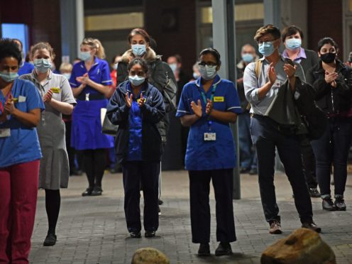 Staff at Bedford Hospital join in with the nationwide clap (Jacob King/PA)