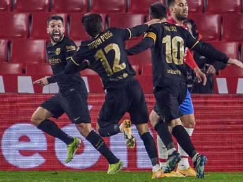 Barcelona's Jordi Alba celebrates after scoring his side's fifth goal against Granada (AP/PA)