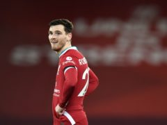 Defender Andy Robertson admits Liverpool are not currently in the title race (Peter Powell/PA)