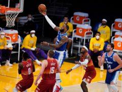 LeBron James, top, was in supreme form against the Denver Nuggets (Marcio Jose Sanchez/AP/PA)