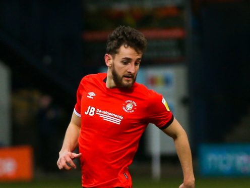 Tom Lockyer will miss out for Luton (Steven Paston/PA)