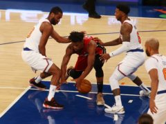 Alec Burks, left and Elfrid Payton, right, of the New York Knicks defends against Jimmy Butler (Mike Stobe/Pool Photo/AP)