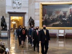 Acting Sergeant at Arms Timothy Blodgett, right, leads Representative. Jamie Raskin, second from right, the lead Democratic House impeachment manager, and other impeachment managers, through the Rotunda to the Senate (Alex Brandon/AP)