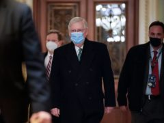 Senate Minority Leader Mitch McConnell arrives at the Capitol on Thursday for the impeachment trial of former president Donald Trump (J Scott Applewhite/AP)
