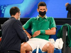 Novak Djokovic receives treatment for a stomach injury (Andy Brownbill/PA)