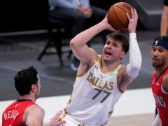 Dallas Mavericks' Luka Doncic puts up a shot (Tony Gutierrez/AP)