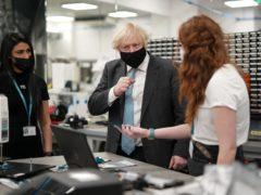 Prime Minister Boris Johnson speaks with senior engineers at the QuantuMDx Biotechnology company (Ian Forsyth/PA)