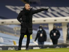 Pep Guardiola does not think the title race is over yet (Tim Keeton/PA)
