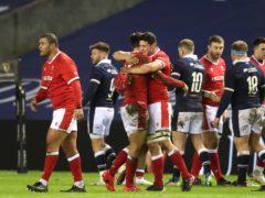 Wales players celebrate beating Scotland at Murrayfield (Jane Barlow/PA)
