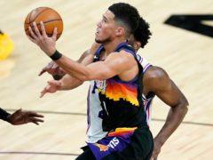 Phoenix Suns guard Devin Booker shoots during his side's win over the Philadelphia 76ers (Matt York/AP)