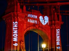 Hammersmith Bridge has been illuminated bright red in a Valentine's Day stunt aimed at highlighting ongoing delays to its repair (Nigel Edwards/Hammersmith Bridge SOS/PA)