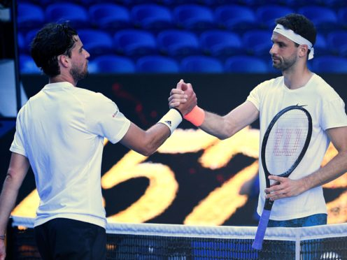 Grigor Dimitrov (right) shakes hands with Dominic Thiem after their fourth-round encounter (Andy Brownbill/AP)