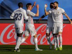 Karim Benzema (right) was on the scoresheet as Real Madrid won 2-0 against Valencia (Manu Fernandez/AP)