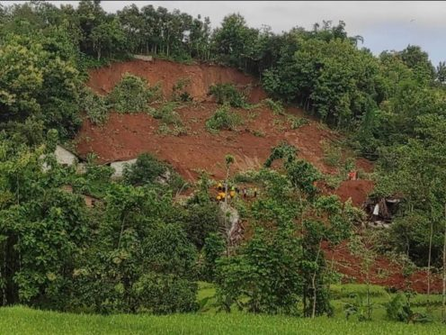 Rescuers search for survivors at a village hit by a landslide in Nganjuk, East Java, Indonesia (National Search and Rescue Agency via AP)