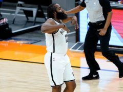 Brooklyn Nets guard James Harden celebrates a 3-pointer against the Phoenix Suns (Matt York/AP)