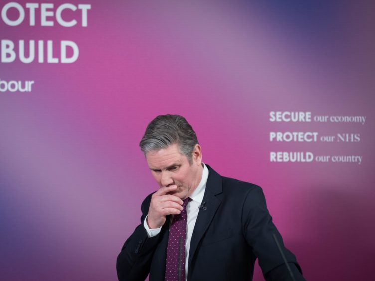 Labour leader Sir Keir Starmer said he is 'very comfortable' with displaying his patriotism and warned that 'competence' on its own will not be enough for his party to win the next general election (Stefan Rousseau/PA)