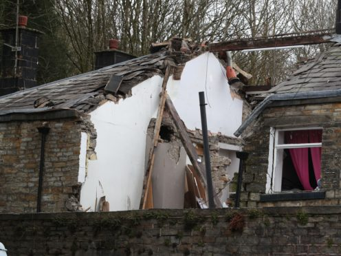 The remains of the property in Ramsbottom, Bury (Peter Byrne/PA)