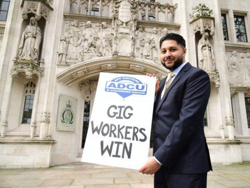 Uber driver Yaseen Aslam outside the Supreme Court, London (Ian West/PA)