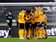 Wolves players celebrate after Illan Meslier's own goal (Alex Pantling/PA)
