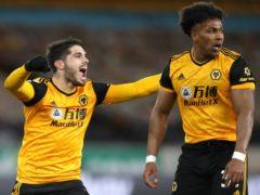 Pedro Neto and Adama Traore celebrate Wolves' winner against Leeds (Nick Potts/PA)