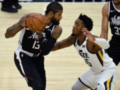 Los Angeles Clippers guard Paul George, left, holds on to the ball while Utah Jazz guard Donovan Mitchell defends (Kelvin Kuo/AP)