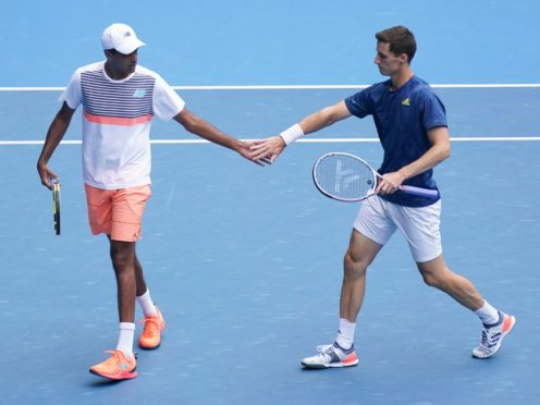 Joe Salisbury (right) and Rajeev Ram were unable to retain their Australian Open title (Mark Dadswell/AP)