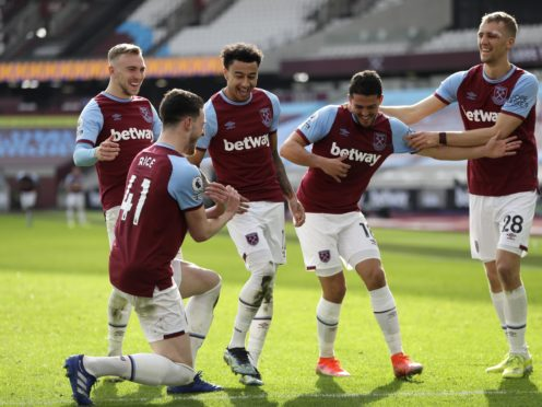 Jesse Lingard (third left) celebrates scoring West Ham's second in a 2-1 win over Tottenham (Kirsty Wigglesworth/PA Images).