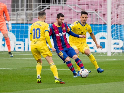 Lionel Messi, centre, was denied victory on his record-breaking appearance for Barcelona (Joan Montfort/AP)