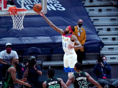 New Orleans Pelicans forward Brandon Ingram goes to the basket in the second half of an NBA basketball game against the Boston Celtics (Gerald Herbert/AP)
