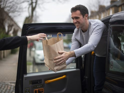 Taxi driver Josh Kelly is using his black cab to deliver specially prepared meals of traditional pie and mash (Victoria Jones/PA)